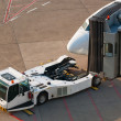 Stock Photo: Airport. Jet and towing truck.