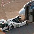 Airport. Jet and towing truck. — Stock Photo #2327400