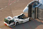 Airport. Jet and towing truck. — Stock Photo