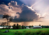 Thundercloud over the house — Stock Photo