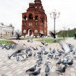Pigeons before a chapel - Stock Photo