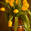 Yellow tulips in clay pot - Stock Photo