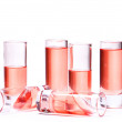 Thin glasses with pink liquid - Stock Photo