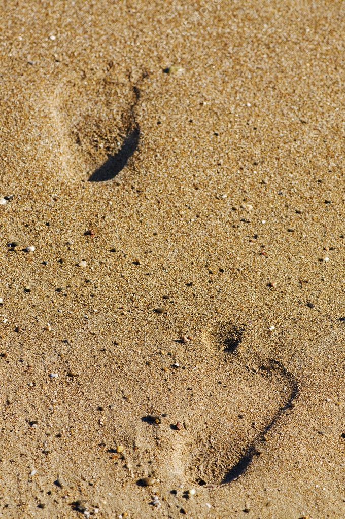 Foot stamp on sand — Stock Photo #1087851