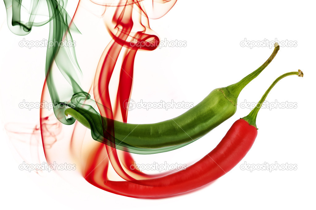 Red and green hot chili pepper with color smoke on white — Stock Photo #1094683