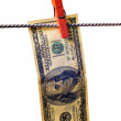 Stock Photo: Drying dollar with clothespin