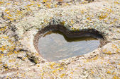 Puddle heart in stone — Stock Photo