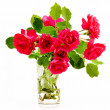 Bouquet of red roses in a glass — Stock Photo