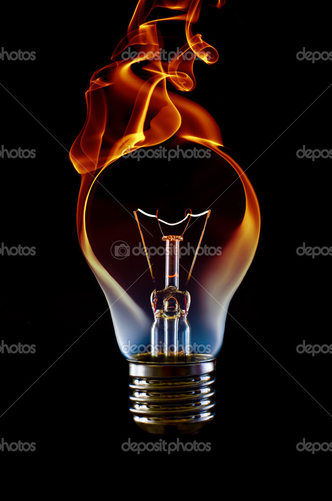 Fire smoke lamp bulb art concept on black — Stok fotoğraf #2123039
