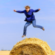 Stock Photo: Jumping on straw roll