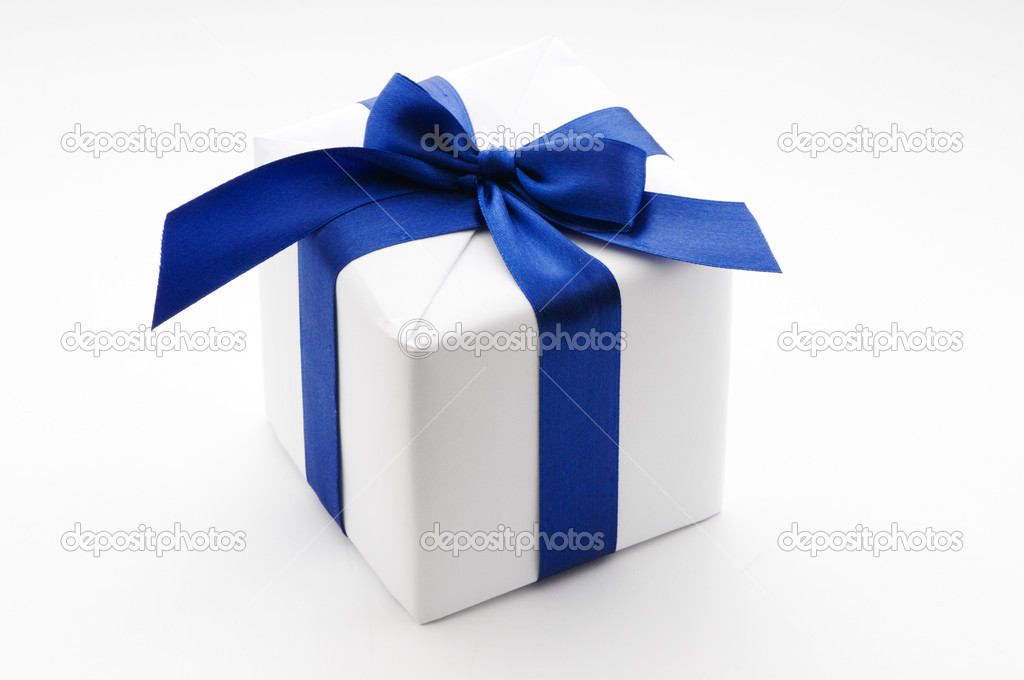 White gift box with blue ribbon — Stock Photo #2377392