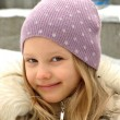 Happy little girl in a lilac hat. — Stock Photo #1035461