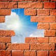 In a hole in the wall, the sun is shinin - Stock Photo