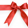 Beautiful red bow on white background — Stock Photo