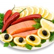 Red fish, lemon, olives on plate isolate — Stock Photo #1196439