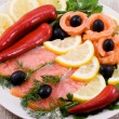 Red fish, lemon, olives on plate — Stock Photo #1196457