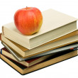 Books and apple on white background — Stock Photo