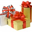 Gold and silver boxes with gifts and bow — Stock Photo