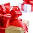Stock Photo: Gold and white boxes with gifts and bows