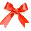 Beautiful red bow on white background — Stock Photo #1335982