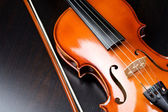 Violin on a dark desk — Stock Photo