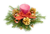 Candle and ribbon in spruce branches — 图库照片