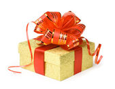 Gold gift box with red ribbons — Stock Photo