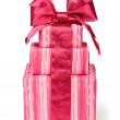 Stock Photo: Gift boxes with red ribbons and bow