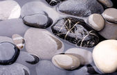 Sea water and stones — Stock Photo