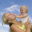 Stock Photo: Happy mother and baby having fun