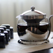 Stock Photo: Teapot with fresh tea and tea boxes