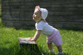Baby girl in garden — Stock Photo