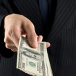 Businessman holding money — Stock Photo