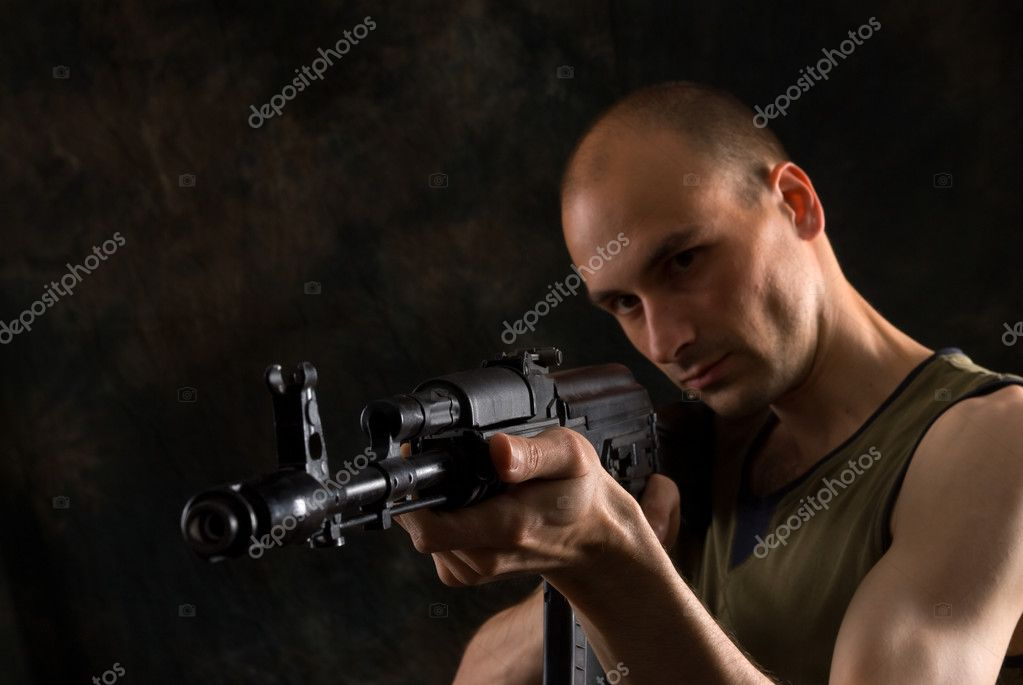 Man with the Kalashnikov gun in the dark — Stock Photo #1059796