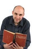 Man Reading an English Book — Stock Photo