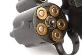 Closeup old revolver with bullets — Stock Photo