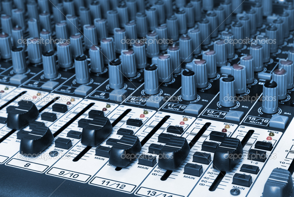 Closeup of a audio mixing board  Photo #1080143
