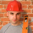 Handyman with red hat - Stock Photo