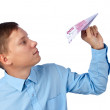 Businessman throwing an airplane — Stock Photo