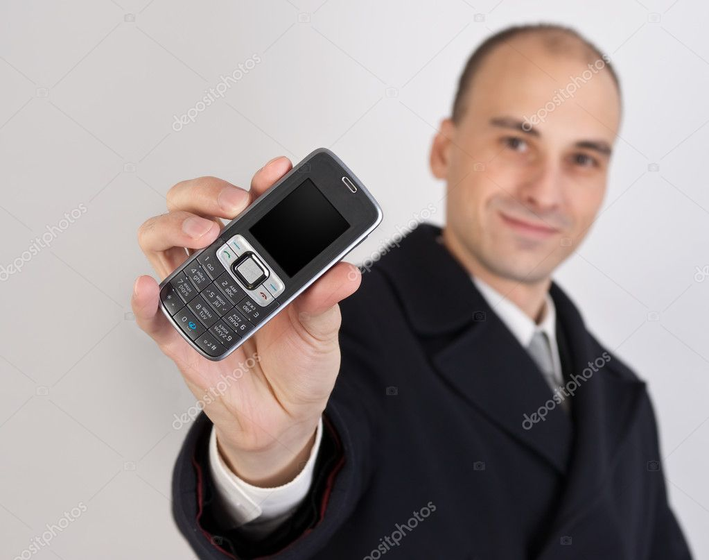 Businessman holding a mobile phone  Stock Photo #1533732