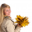 Woman with yellow leaves — Stock Photo