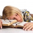 Young woman sleeping over books - Stock Photo