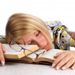 Young woman sleeping over books — Stock Photo