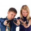 Foto Stock: Man and woman with guns