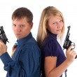 Stock Photo: Mand womwith guns