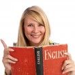 Happy young woman with a book — Stock Photo