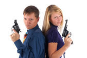 Man and woman with guns — Stock Photo