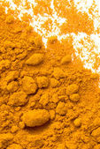 Powder of the dried up roots is known as spice Curcuma — Stock Photo