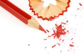 Red pencil with pencil shavings — Stock Photo