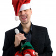 Happy business man in a Santa hat — Stock Photo